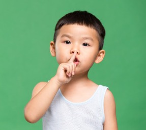 61711643 - little boy making a hush gesture